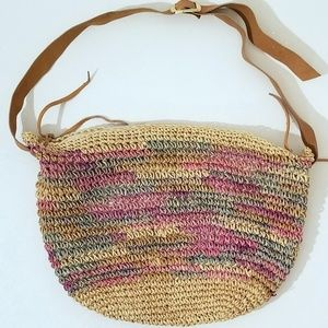 Straw purse tote with leather strap and accents